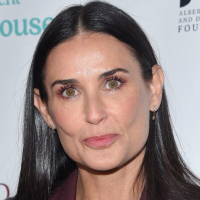 Close up photo of Demi Moore at a red carpet event.