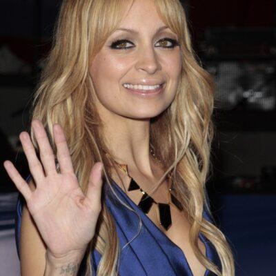 Close up photo of Nicole Richie waving to photographers