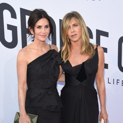 Courteney Cox on the left, Jennifer Aniston on the right, both wearing black dress at a red carpet event.