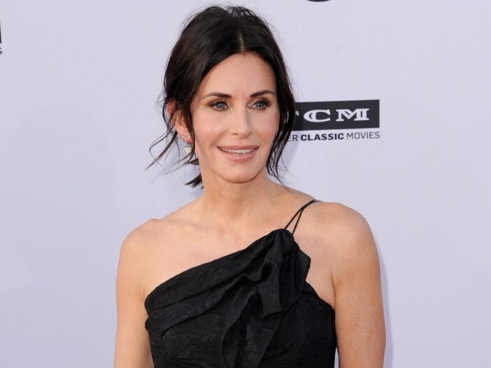 Courteney Cox wearing a black dress at a gala tribute to fellow actor George Clooney