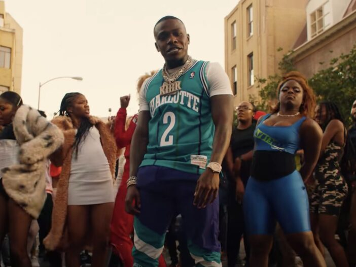 DaBaby rapping in his music video for BOP on Broadway