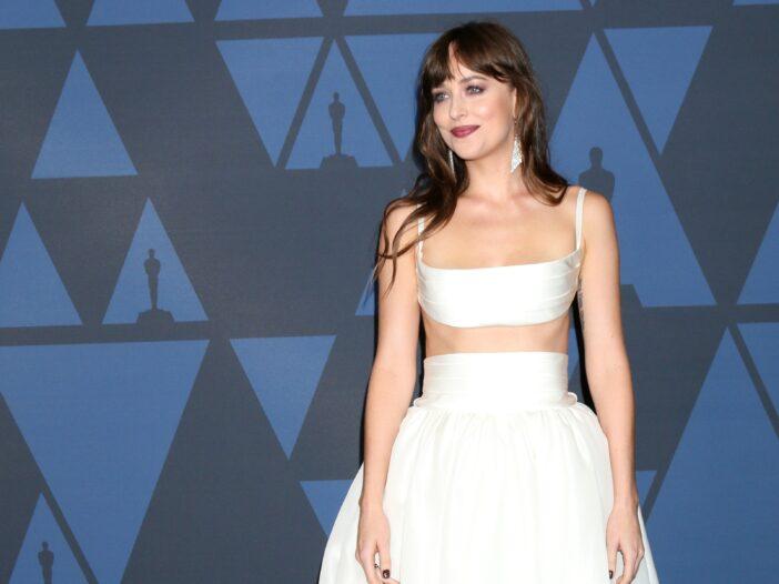 Dakota Johnson wearing a two-piece white dress to the Governors Award