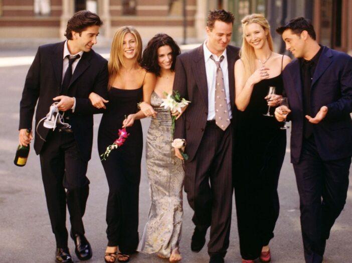 David Schwimmer, black suit; Jennifer Aniston, black dress; Courteney Cox, ivory dress; Matthew Perr