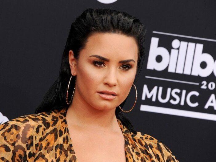 Demi Lovato looking fierce in an animal print top.