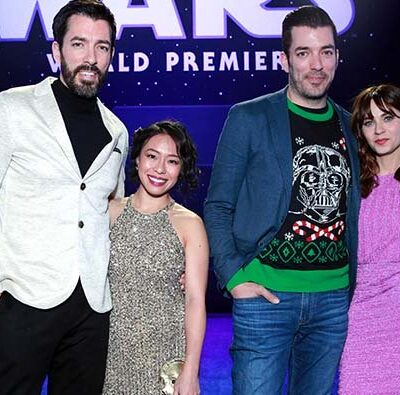 Drew Scott with his wife Linda posing with Jonathan Scott and Zooey Deschanel at the Star Wars: Rise