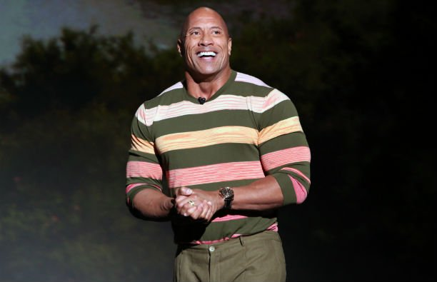 """Dwayne """"The Rock"""" Johnson in a sunset-ombre stripped shirt at the D23 Expo"""