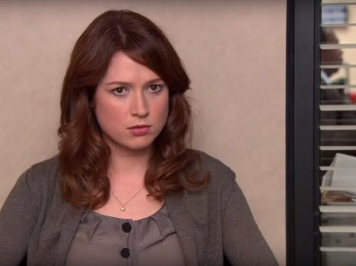 Ellie Kemper in a dark blouse and cardigan as Erin on NBC's The Office