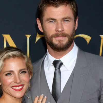 Elsa Pataky and Chris Hemsworth posing together at a Hollywood film premiere.