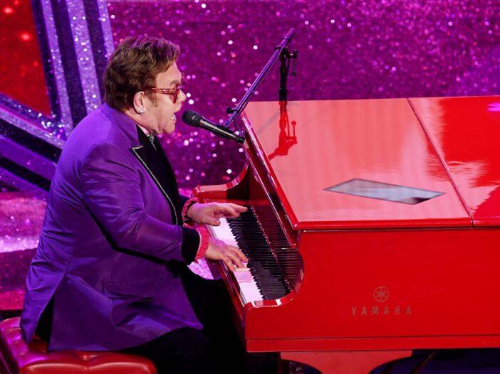 Elton John singing and playing piano at the Academy Awards