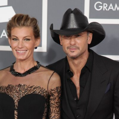 Faith Hill in black on the left, Tim McGraw on the right in a cowboy hat.
