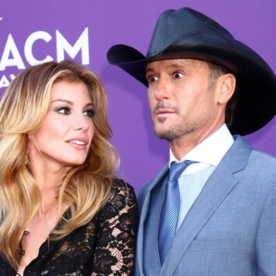 Faith Hill looks at her husband, Tim McGraw, as the two arrive at the Country Music Awards