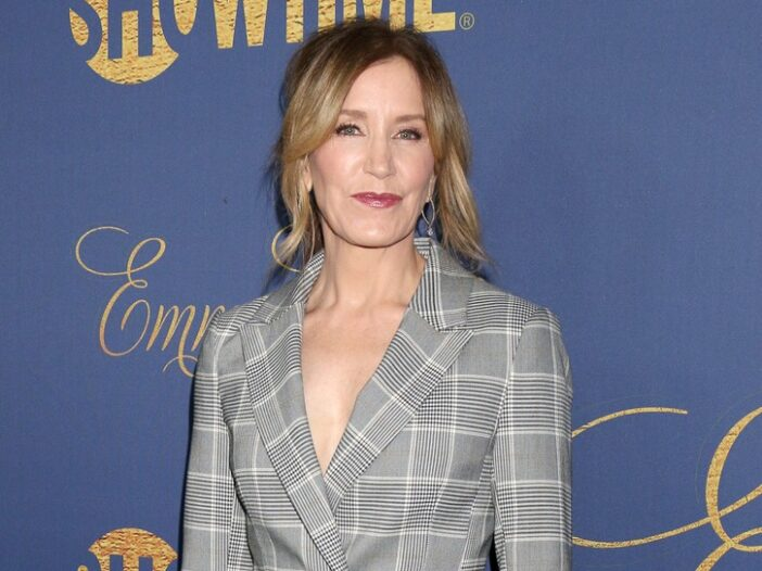 Felicity Huffman in a gray suit.