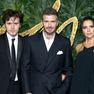 From left to right: Brooklyn Beckham, David Beckham, Victoria Beckham.