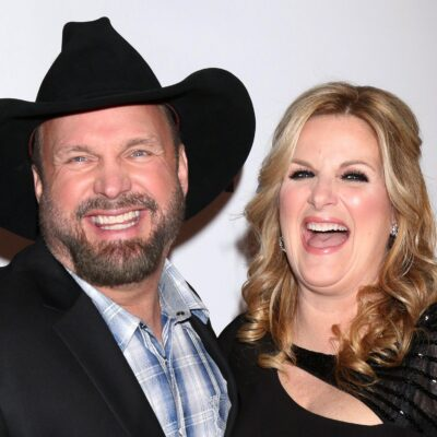 Garth Brooks, right, standing and laughing with Trisha Yearwood.