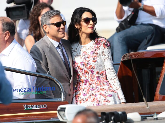 George and Amal Clooney get into a car after leaving a gala in Venice, Italy