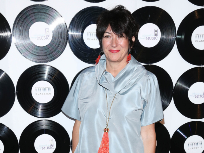 Ghislaine Maxwell wearing a shapeless mint-colored frock while walking the red carpet at the ETM Chi