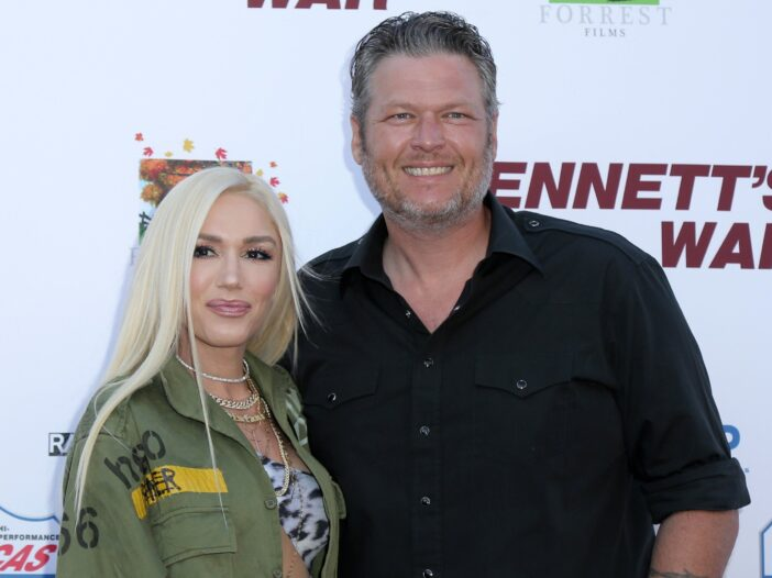 Gwen Stefani in a military-type green jacket on the left, Blake Shelton on the right in a black shirt.
