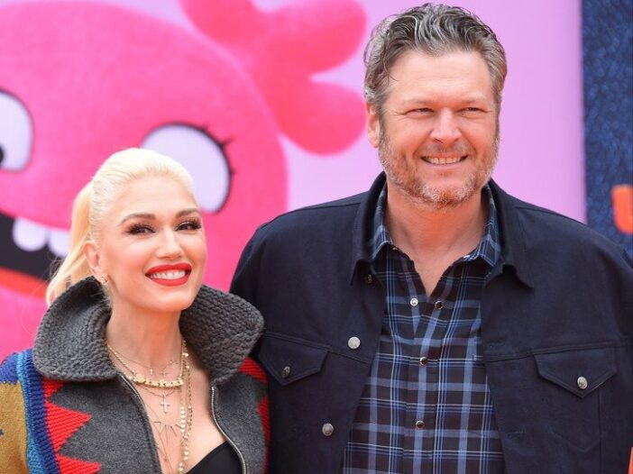Gwen Stefani, in a multicolored jacket, arrives at the Ugly Dolls world premiere with Blake Shelton