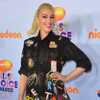 Gwen Stefani wearing a black denim dress with patches sewn on it at the Kids' Choice Awards