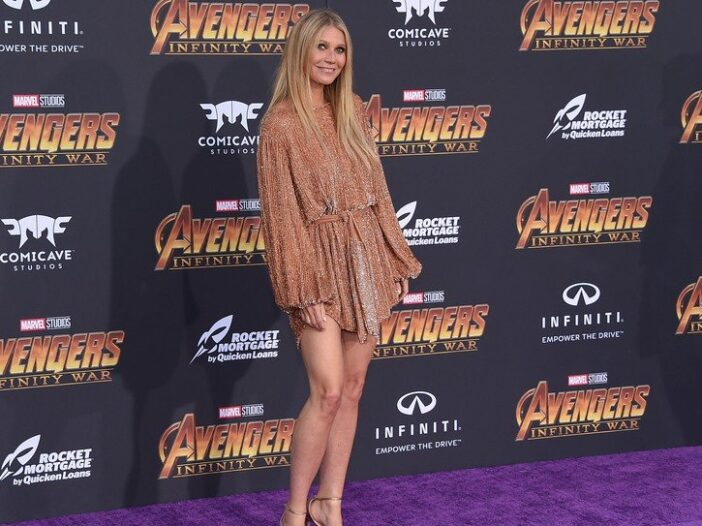 Gwyneth Paltrow wearing a bronze, sparkly dress to the premiere of Avengers Infinity War