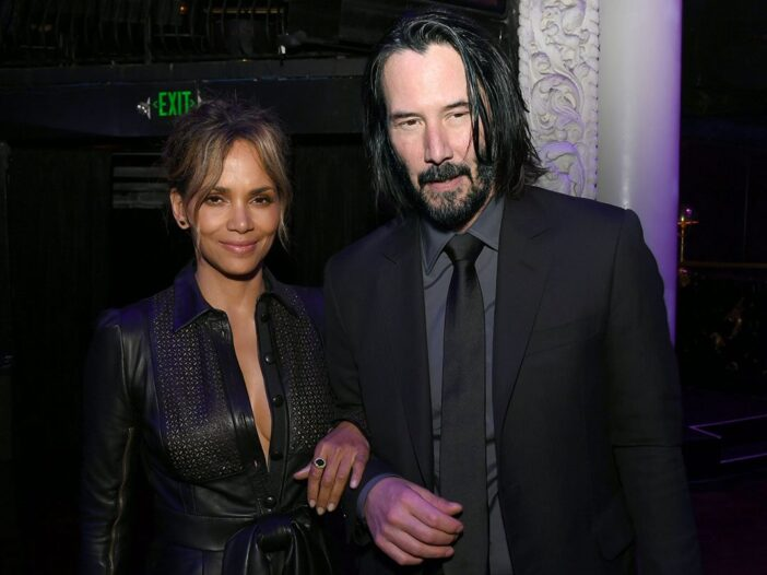 Halle Berry on the left, arm in arm with Keanu Reeves at the John Wick 3 premiere