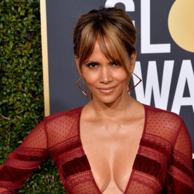 Halle Berry wearing a red dress with a plunging neckline tot he Golden Globe Awards