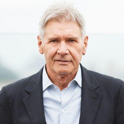 Harrison Ford in a dark blazer.