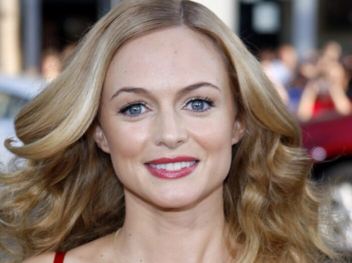 Heather Graham wears a low cut red dress to the premiere of The Hangover