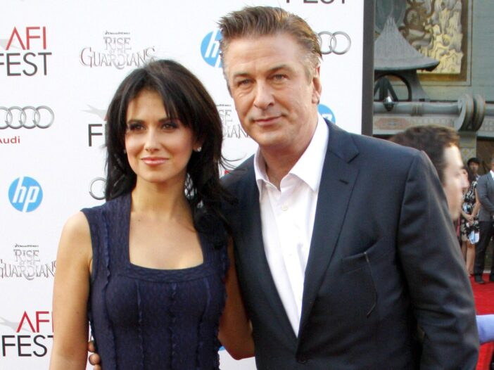 Hilaria Baldwin on the left in a blue dress, Alec Baldwin on the right in a suit.