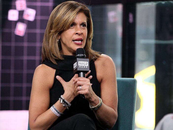 Hoda Kotb looking confused, holding a microphone.