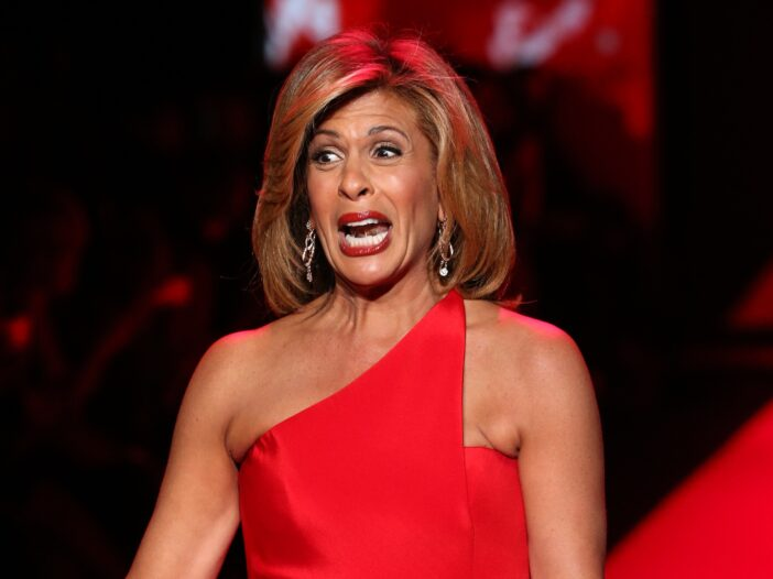 Hoda Kotb pulls a dramatic face as she walks the runway in a red dress