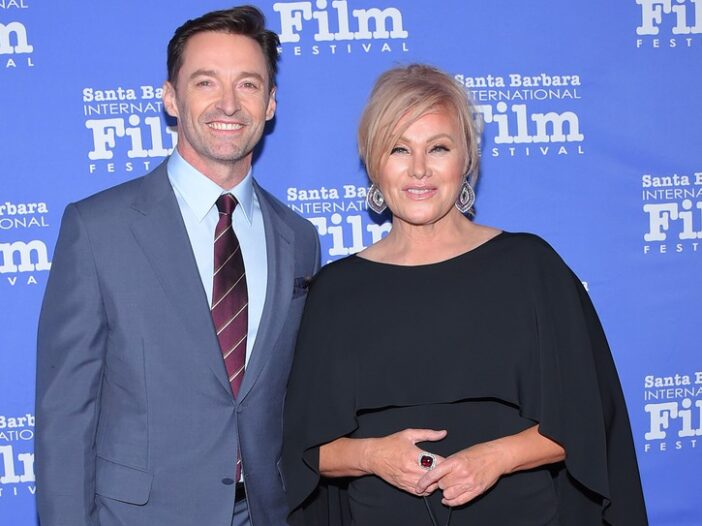 Hugh Jackman on the left in a suit, Deborra-Lee Furness on the right in black.