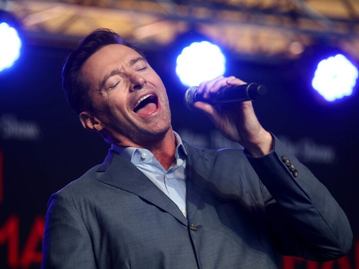 Hugh Jackman performs with students from AUT's South Campus on February 27, 2019 in Auckland, New Ze