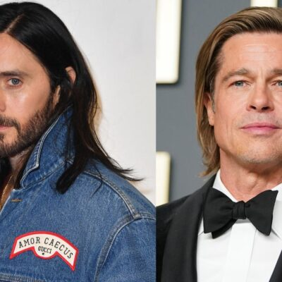 Jared Leto wearing a jean jacket on the red carpet. Brad Pitt wearing a black tux on the red carpet