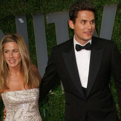 Jennifer Aniston and John Mayer holding hands at a red carpet event in 2009