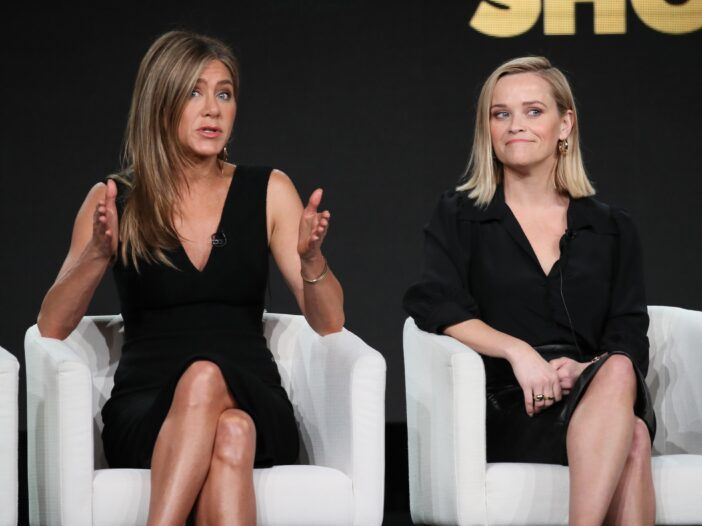 """Jennifer Aniston and Reese Witherspoon of """"The Morning Show"""" speaks onstage during the Apple TV+ seg"""