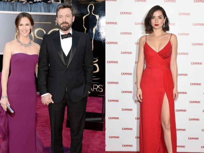 Jennifer Garner in a purple dress standing with Ben Affleck, who's wearing a black tux, on the red c