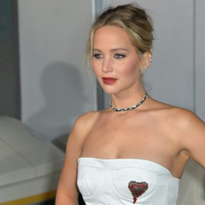 Jennifer Lawrence wearing a white halter-top dress.