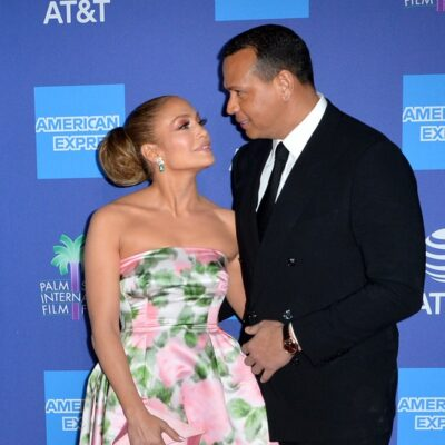 Jennifer Lopez and Alex Rodriguez looking in each other's eyes at a red carpet event.