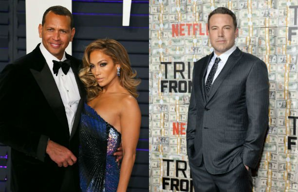 Jennifer Lopez, wearing a blue dress, stands with Alex Rodriguez, wearing a black tux, on the red ca