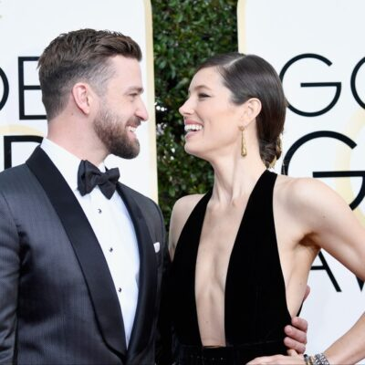 Jessica Biel on the right, laughing with Justin Timberlake at the Golden Globes awards.