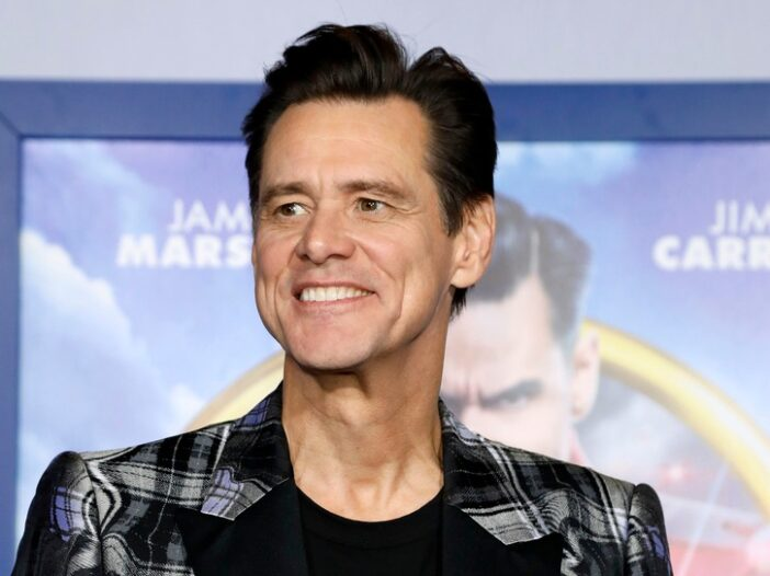 Jim Carrey wearing a black and white plaid blazer to the premiere of Sonic The Hedgehog
