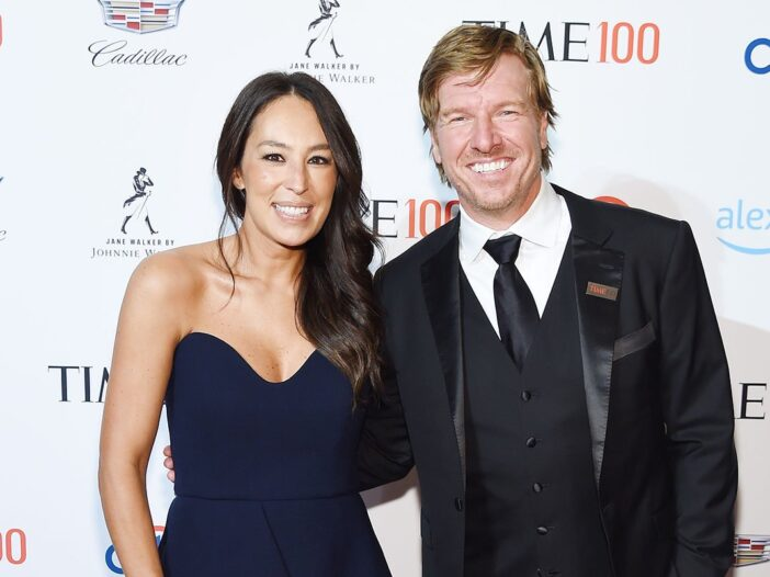 Joanna Gaines and Chip Gaines in formal wear at a red carpet event