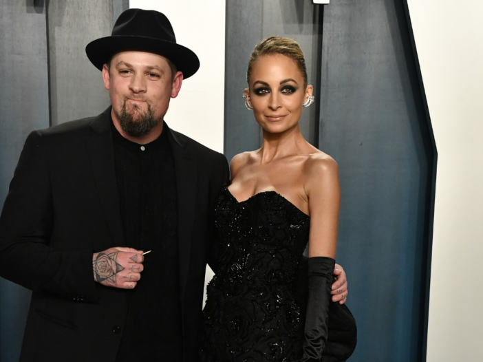 Joel Madden and Nicole Richie, both dress head to toe in black, attending the Vanity Fair Oscar part