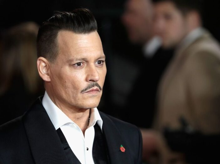 Johnny Depp in a black suit on the red carpet