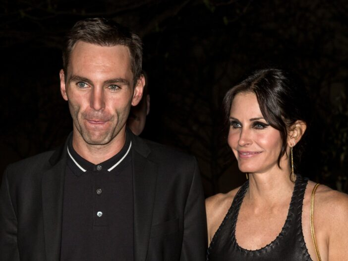 Johnny McDaid on the left, Courteney Cox on the right.