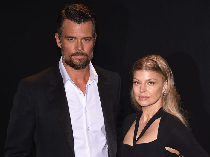 Josh Duhamel and Fergie standing on the red carpet after arriving for a Tom Ford fashion show