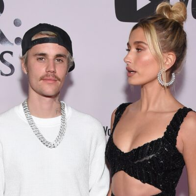 Justin Beiber on the left in a white shirt, Hailey Baldwin on the right in a sparkly black dress.