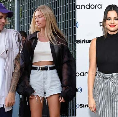 Justin Bieber and Hailey Baldwin walking together side by side with a photo of Selena Gomez at Siriu