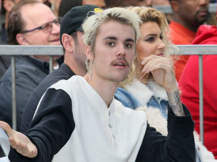 Justin Bieber attends an event honoring Sir Lucian Grainge with a star on the Hollywood Walk of Fame